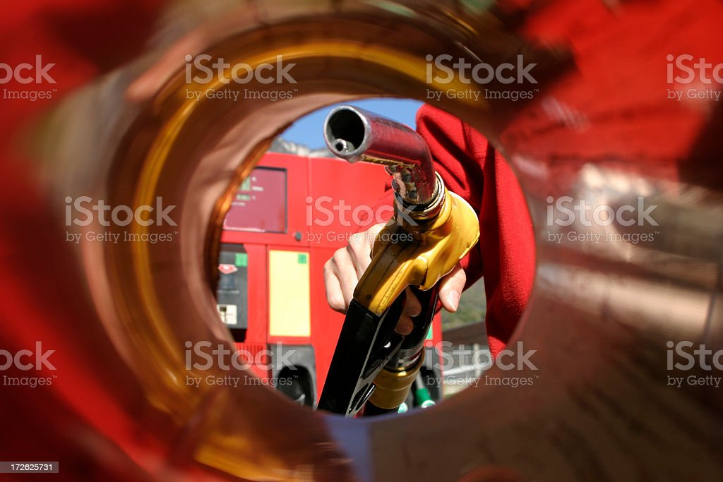 A person filling up the car in a gas station stock photo
