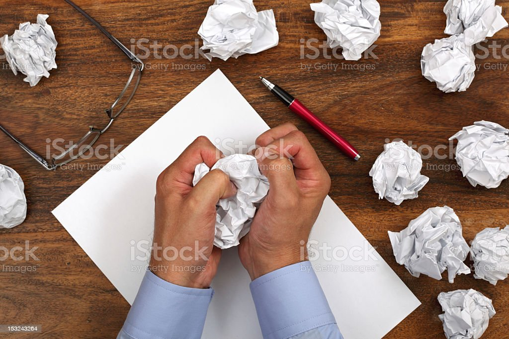 Person frustrated with writers block stock photo