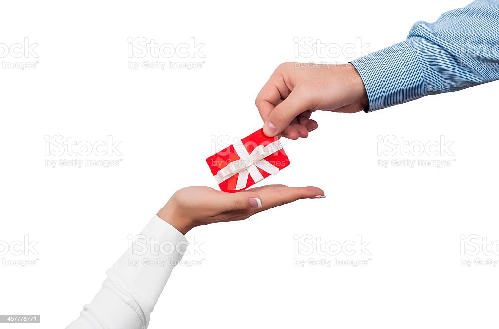 Person giving another person a red gift card stock photo