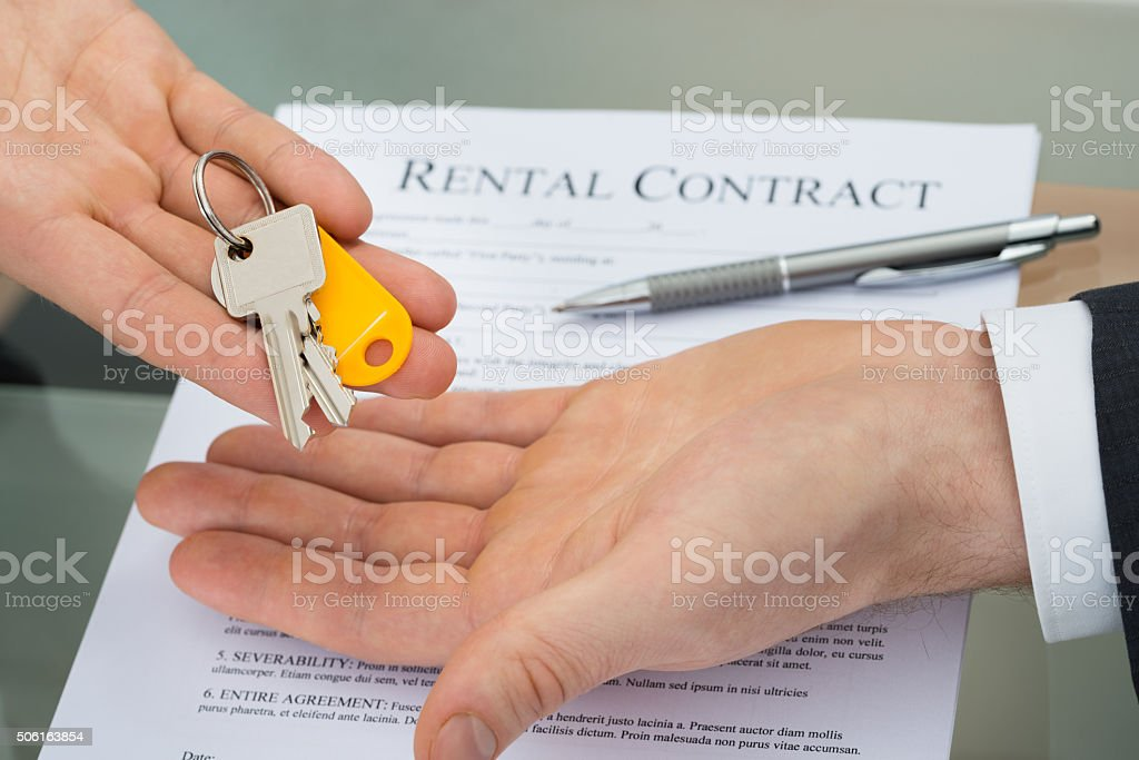 Person Giving Key To Man stock photo