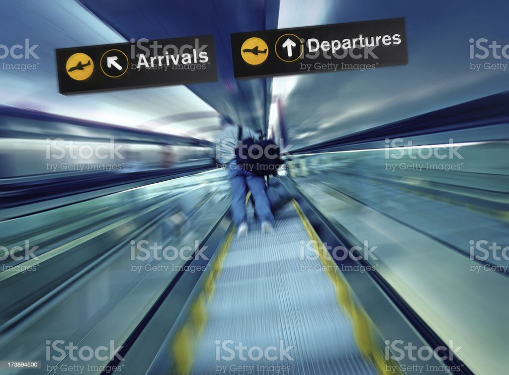 Person Going Up on Escalator at the Airport stock photo