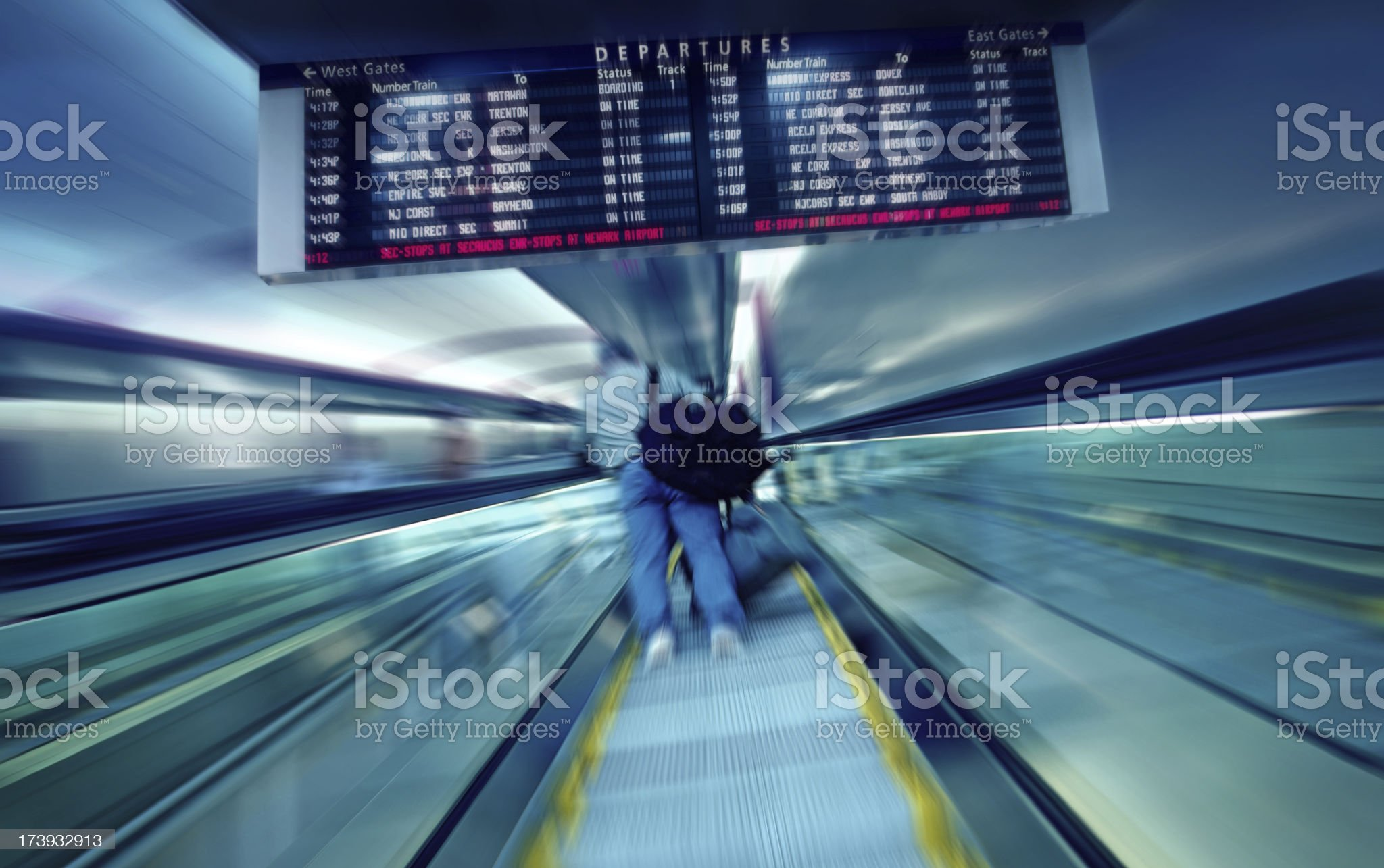 Person Going Up on Escalator at the Railway Station royalty-free stock photo