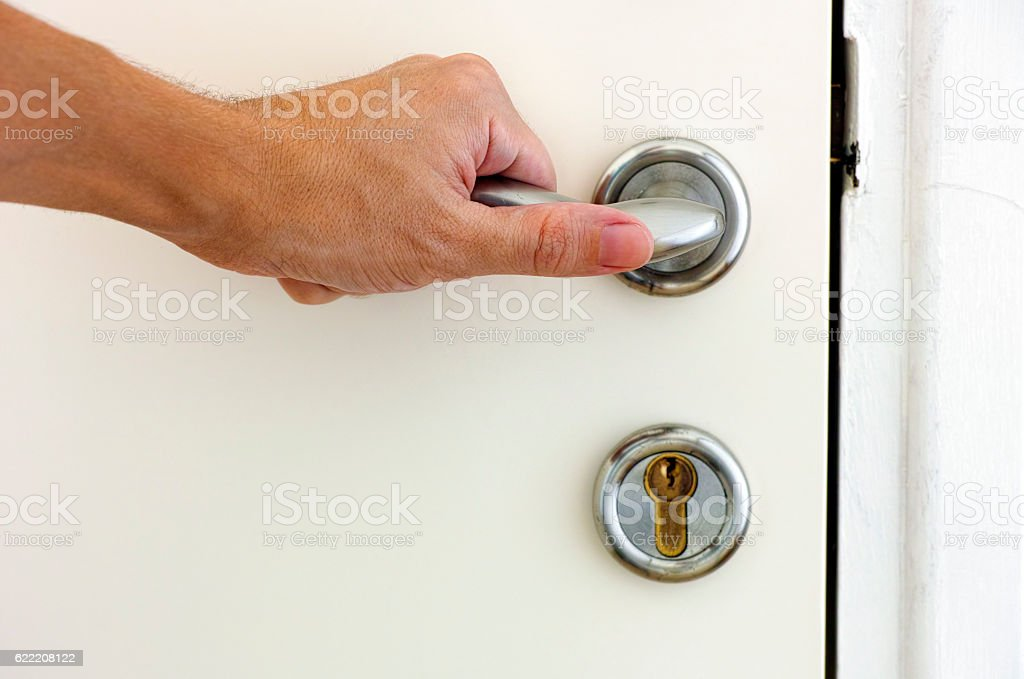 Person Hand On Door Handle stock photo 622208122 | iStock