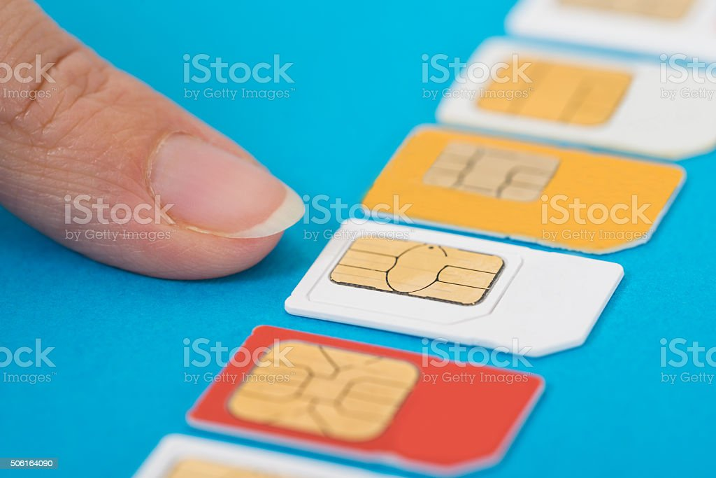 Person Hand Selecting Sim Card stock photo