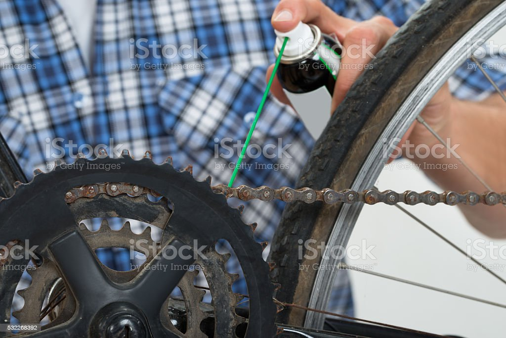 Person Hands Lubricating Bike stock photo