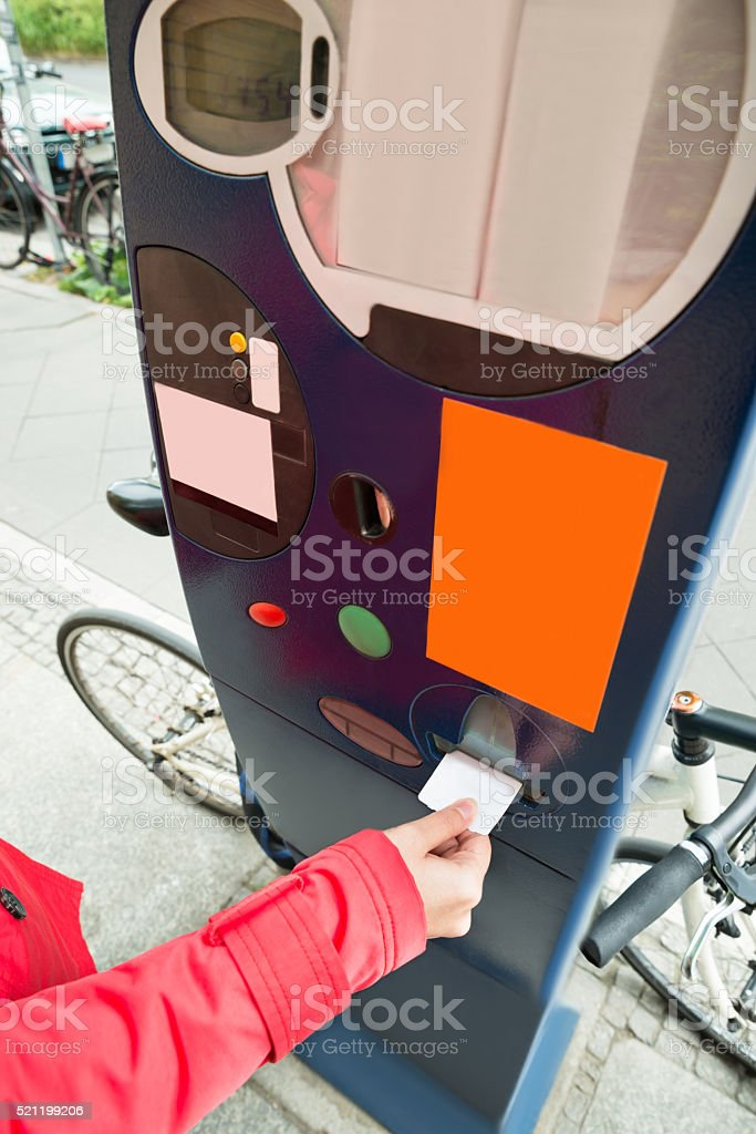 Person Hands Paying For Parking stock photo