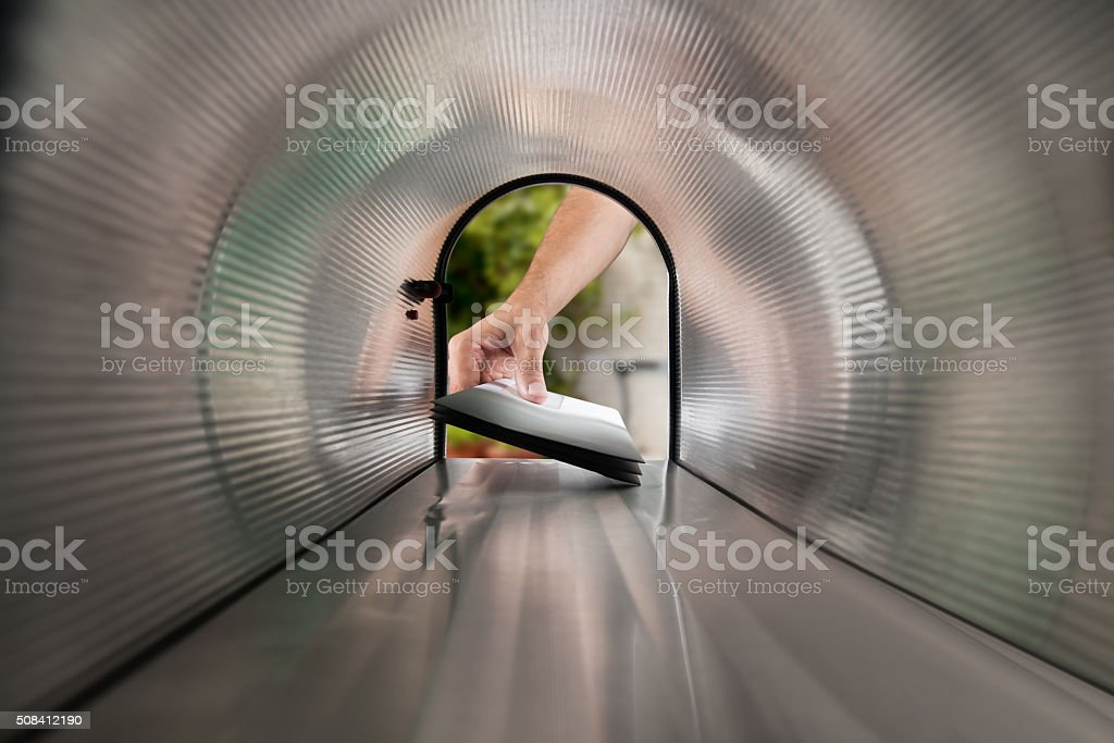 Person Hands Taking Letters View From Inside The Mailbox stock photo