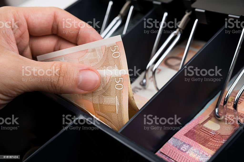 Person Hands With Money Over Cash Register stock photo