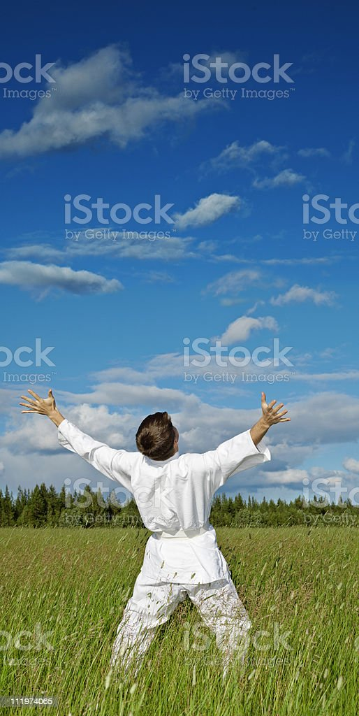 Person has lifted hands to blue sky - happiness stock photo