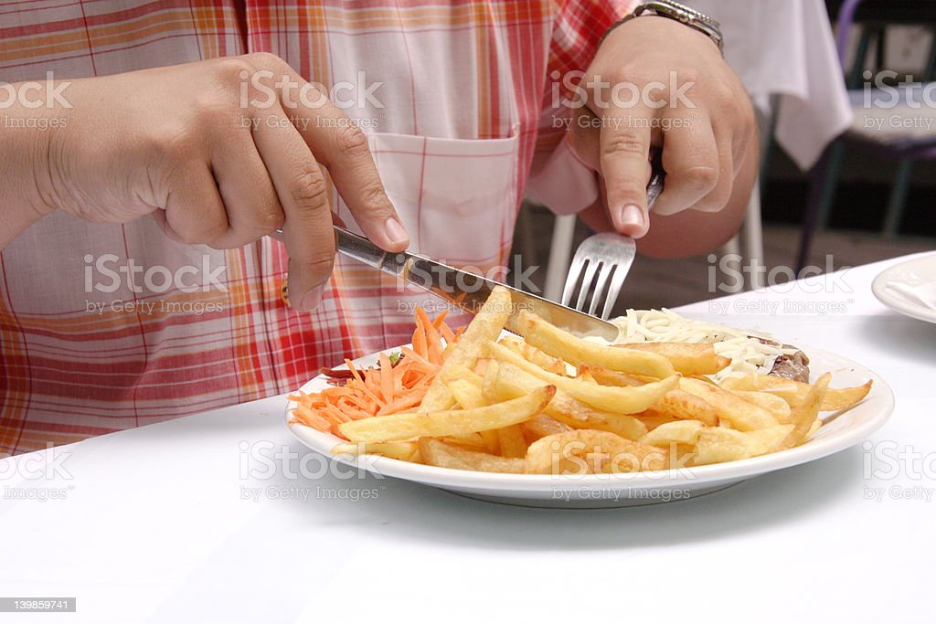 Person having a meal in restaurant royalty-free stock photo