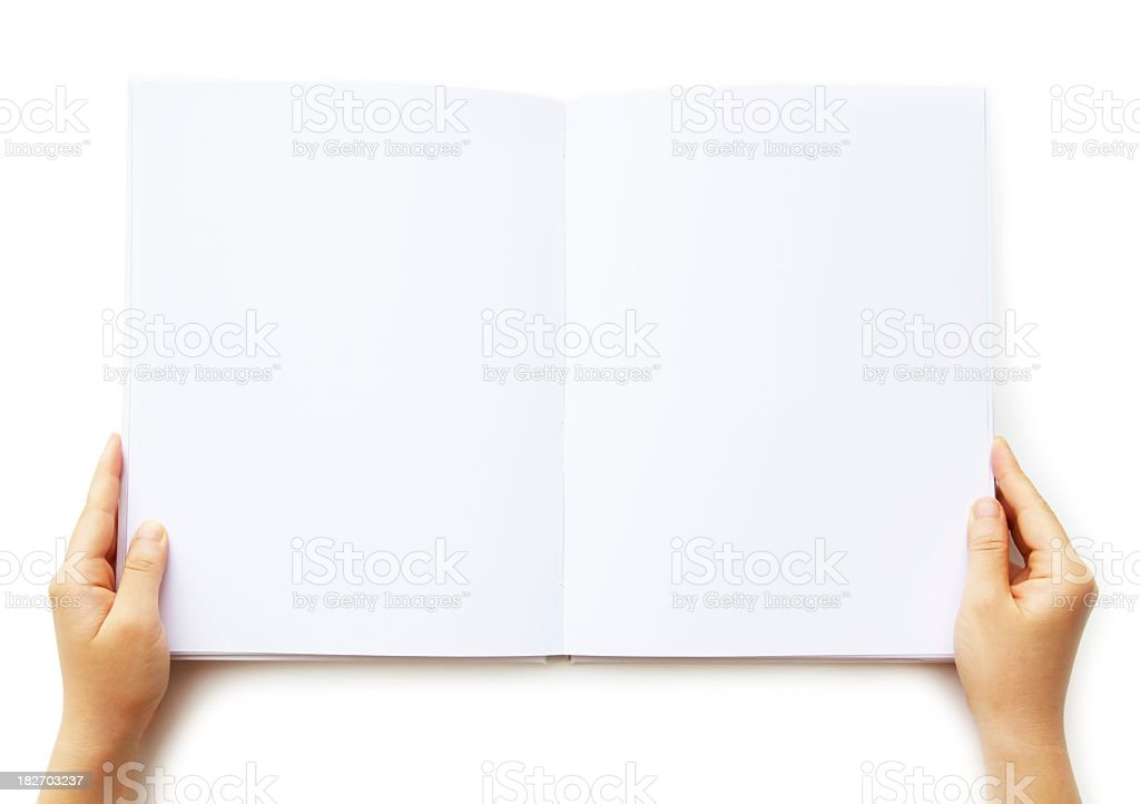 A person holding a blank book of paper  stock photo