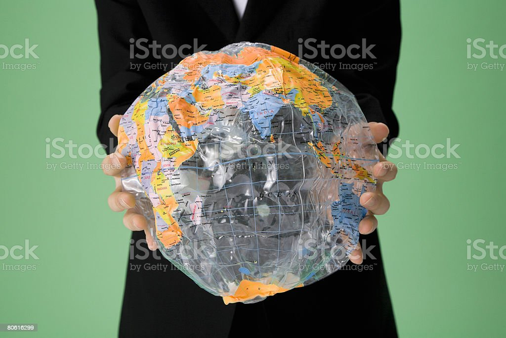 Person holding a deflated globe royalty-free stock photo