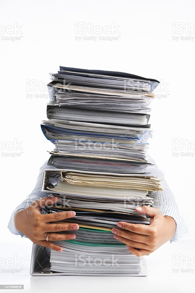 Person holding a large stack of files stock photo