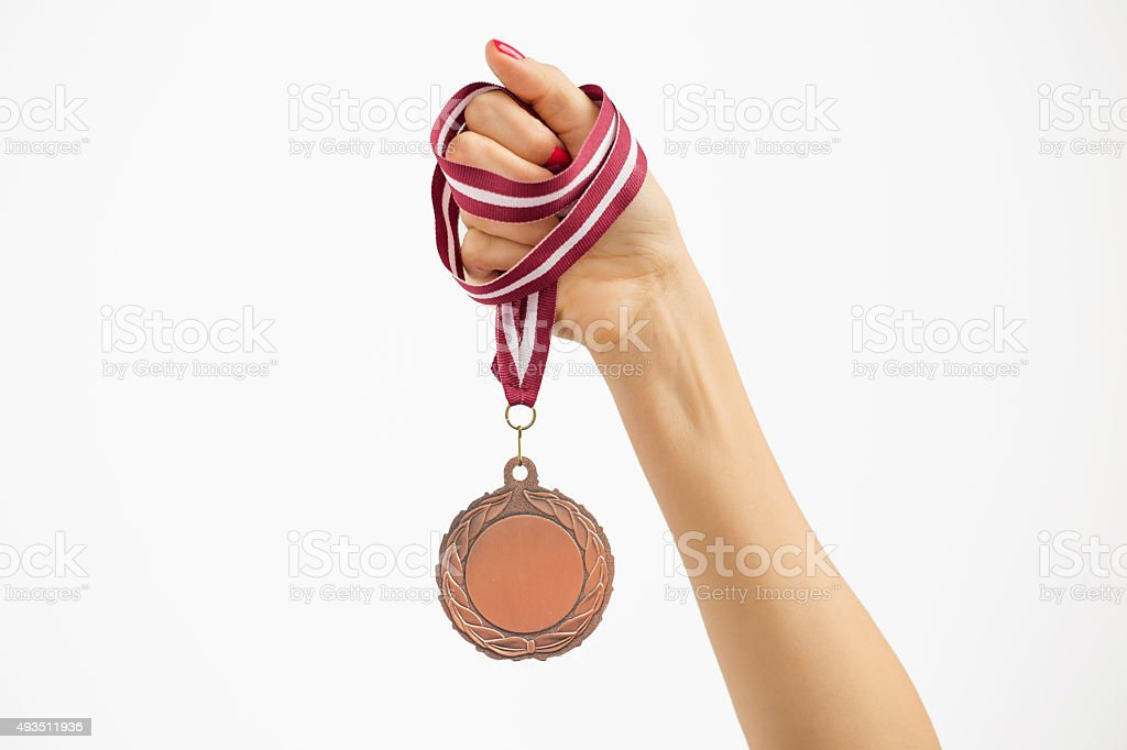 Person holding a medal stock photo