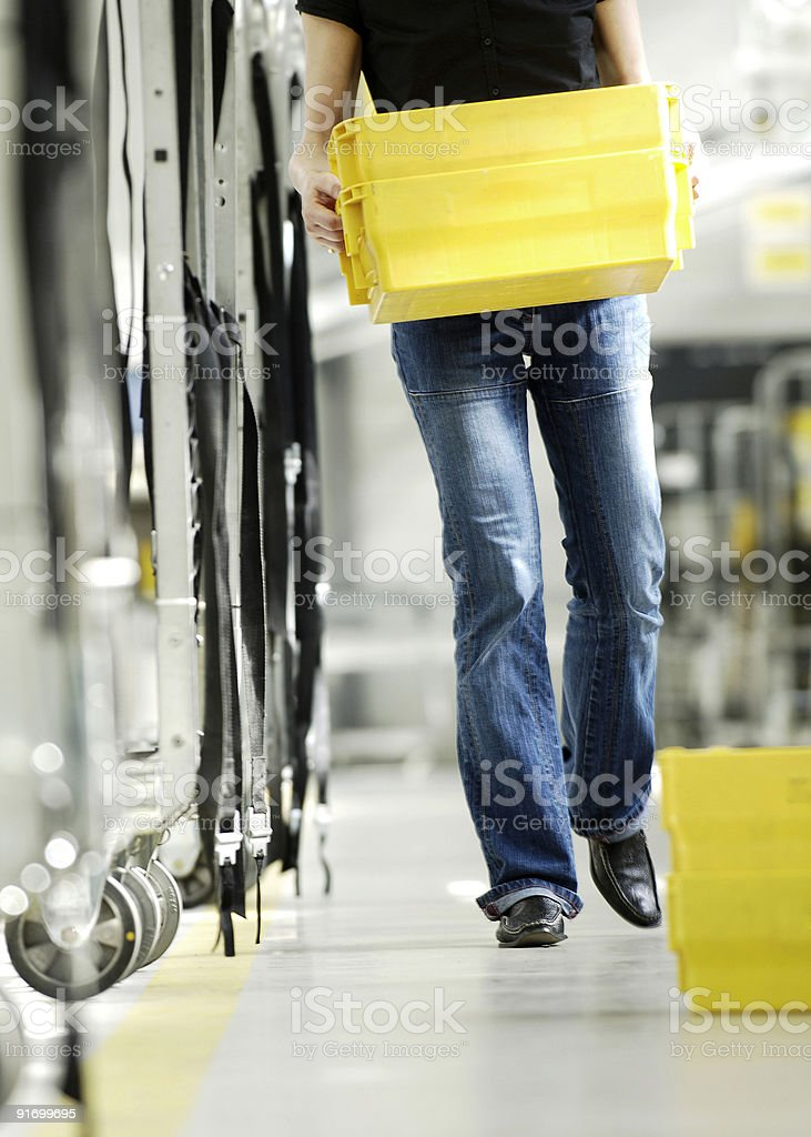 Person holding a yellow container stock photo