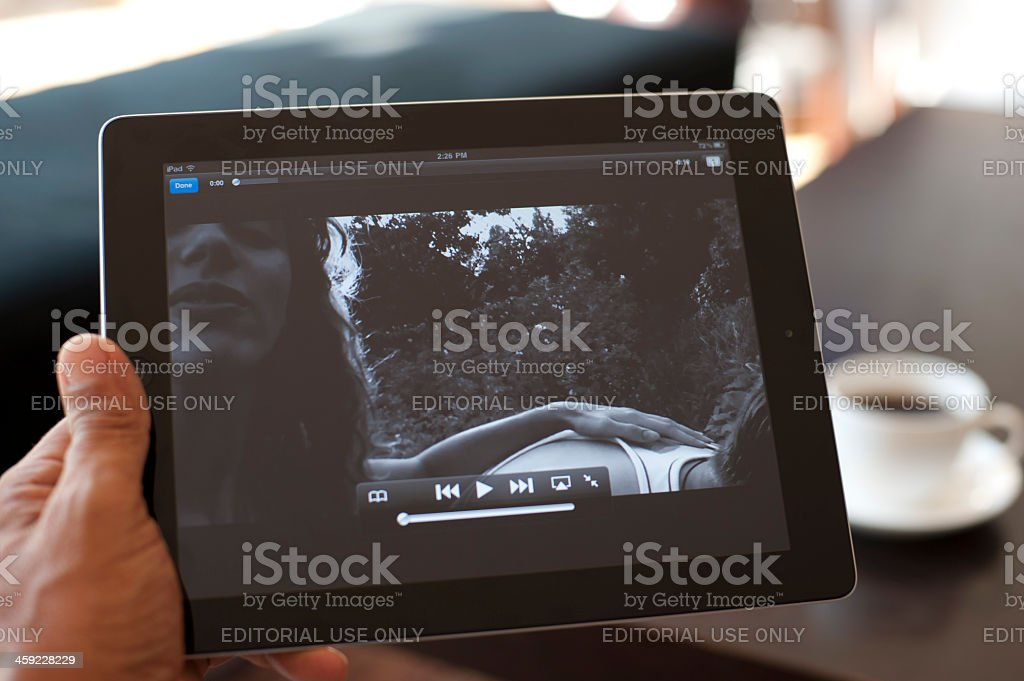 Person holding an ipad showing Youtube royalty-free stock photo