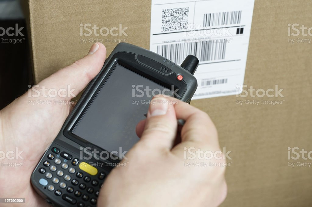 Person Holding Barcode Scanner Taking Inventory royalty-free stock photo