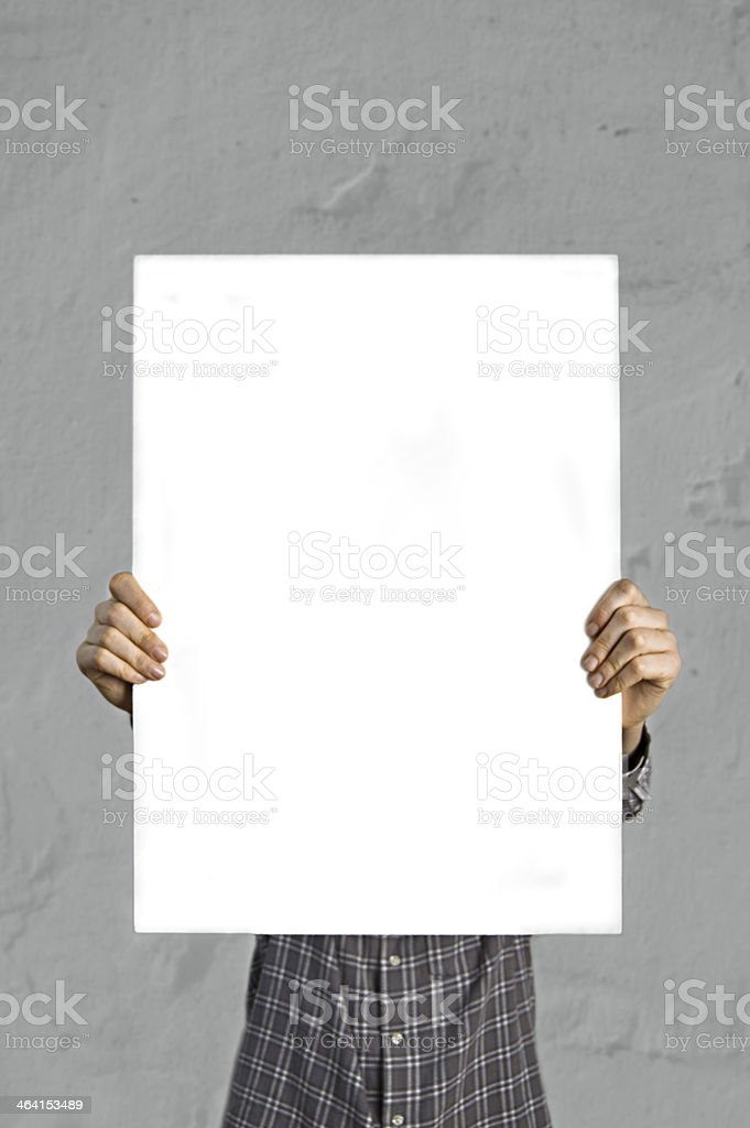 Person holding blank white banner stock photo