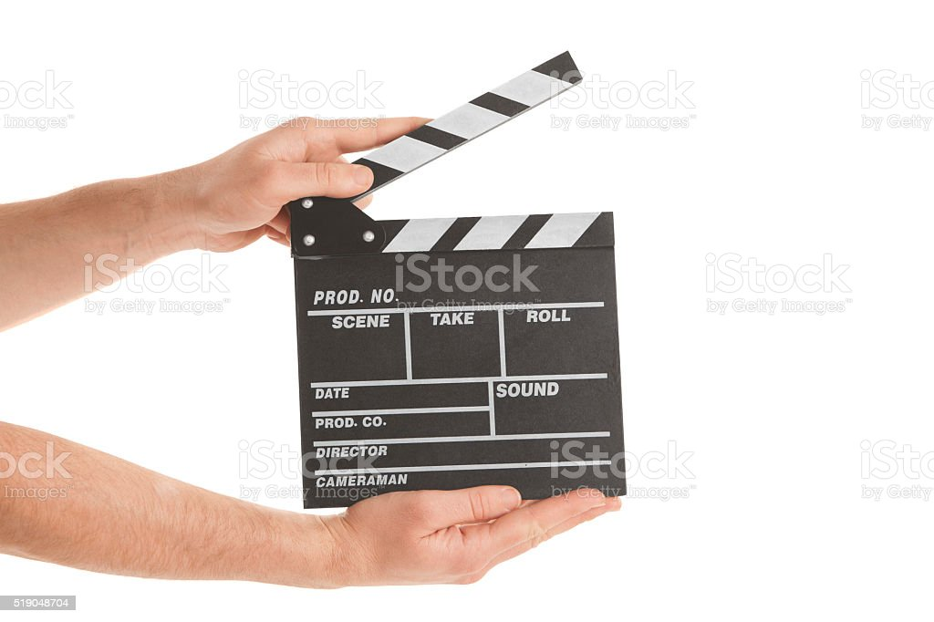 Person holding clapperboard stock photo