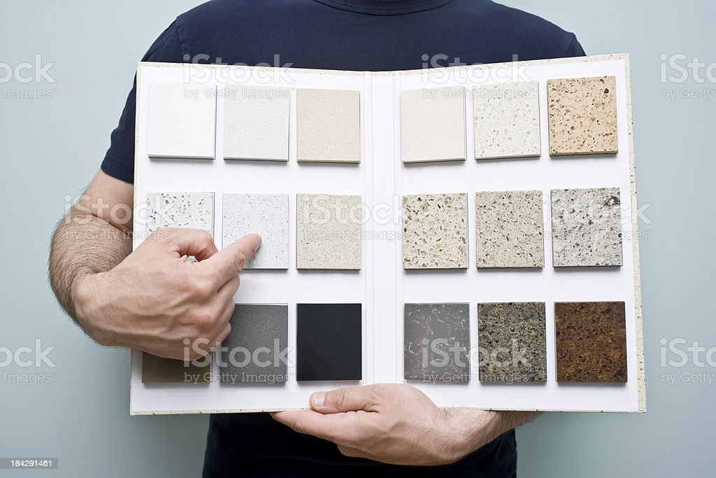 Person holding countertop sample folder stock photo