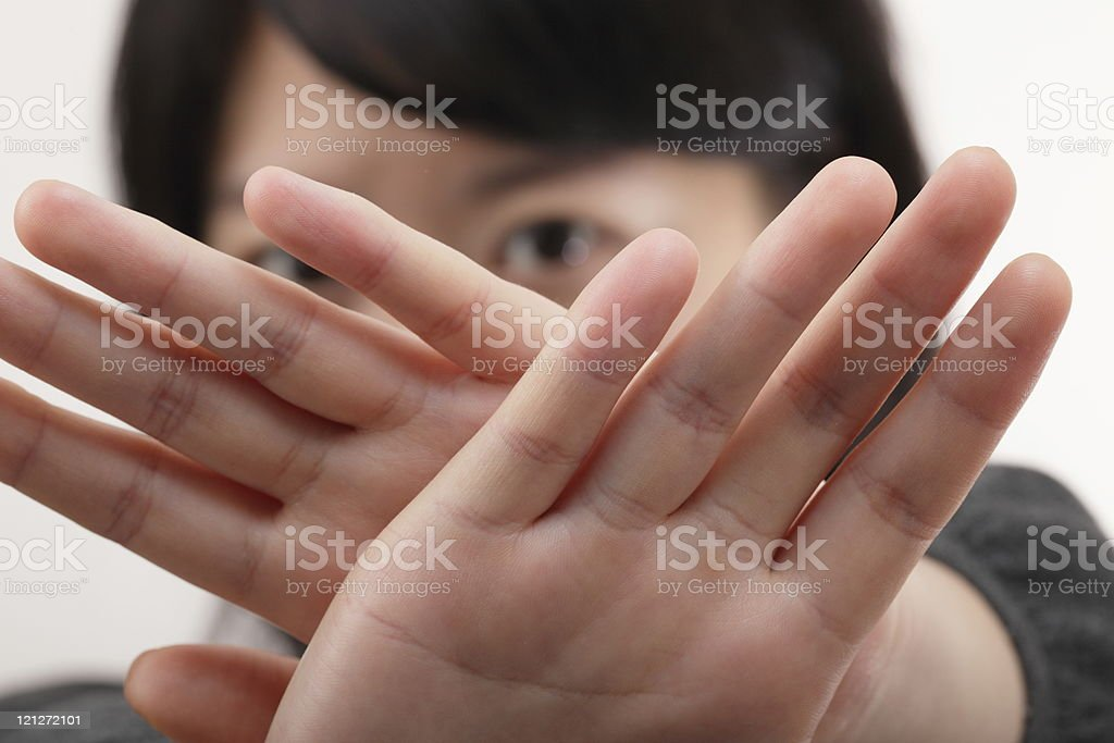Person holding hands up to camera to stop picture stock photo