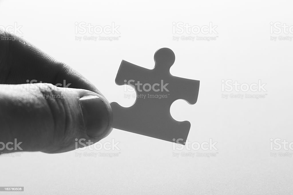 Person Holding Jigsaw Puzzle Piece royalty-free stock photo