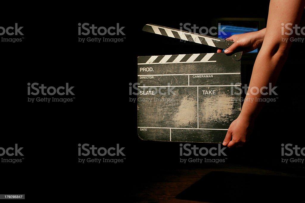 Person holding movie clapper board stock photo