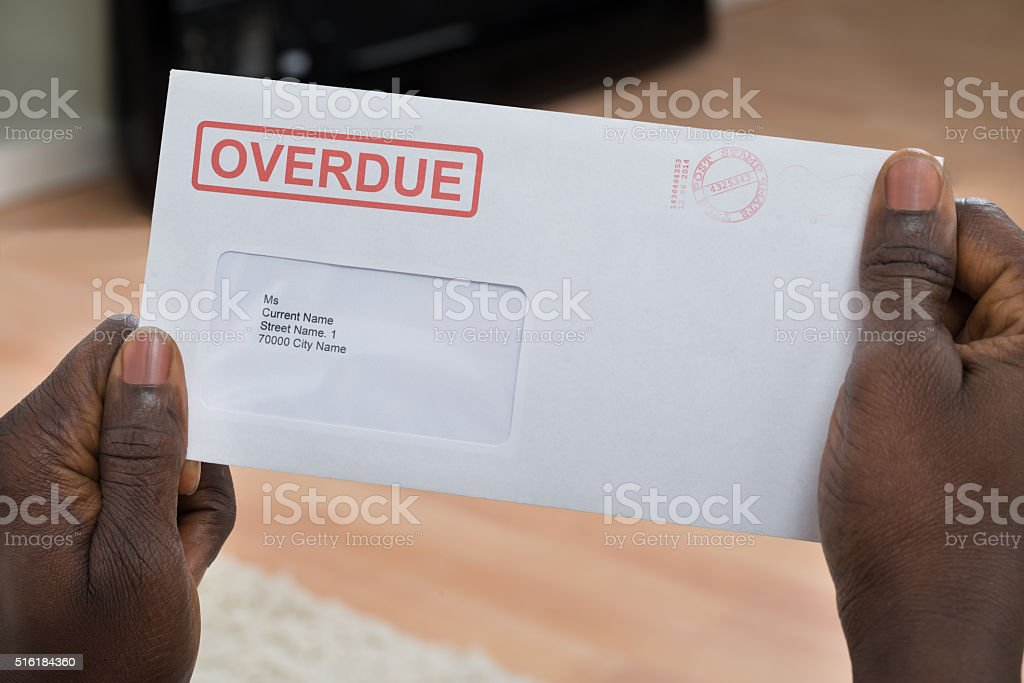 Person Holding Overdue Notice stock photo