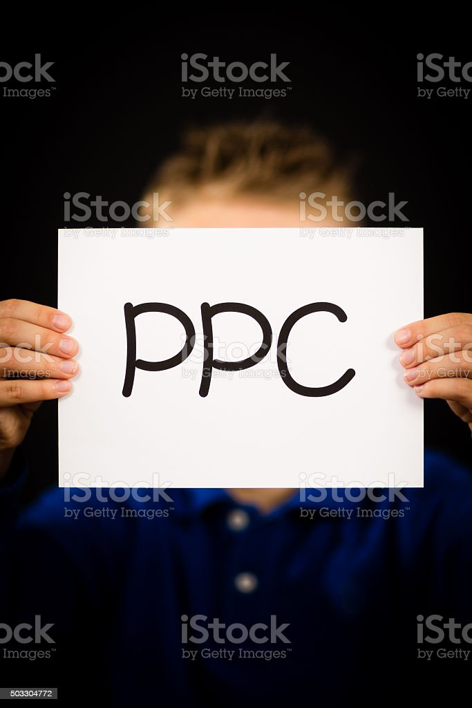 Person holding PPC sign stock photo