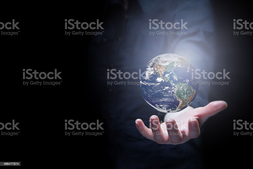 Person holding the earth on their hand stock photo