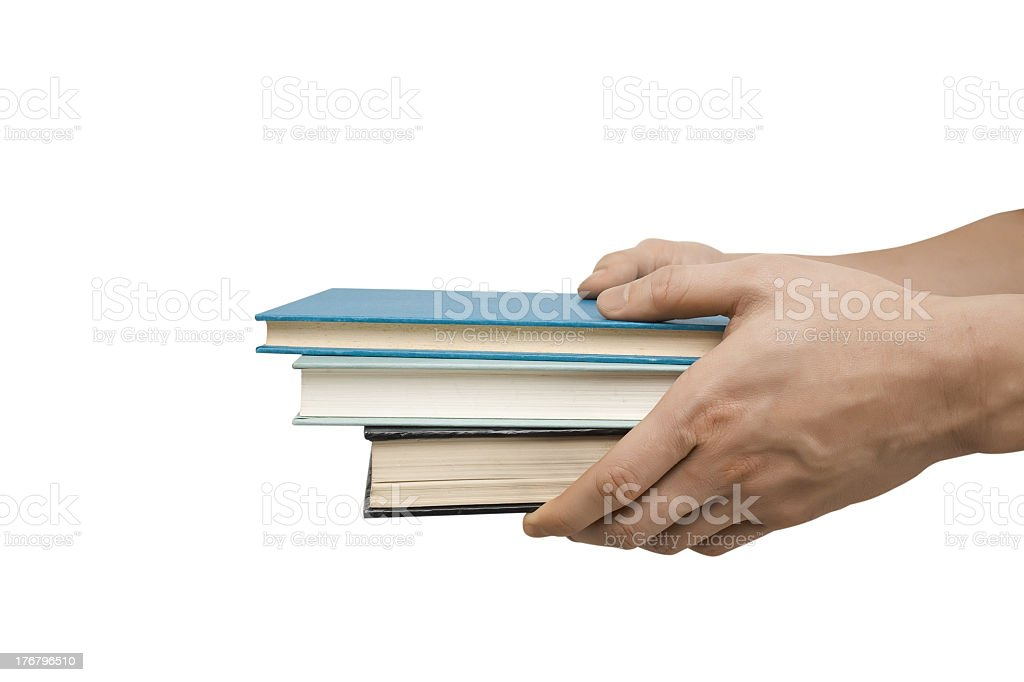 Person holding three hardcover books on a white background stock photo