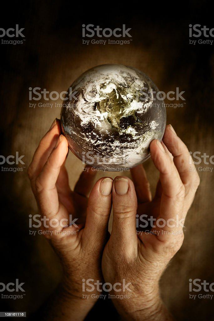 Person Holding World in Hands royalty-free stock photo