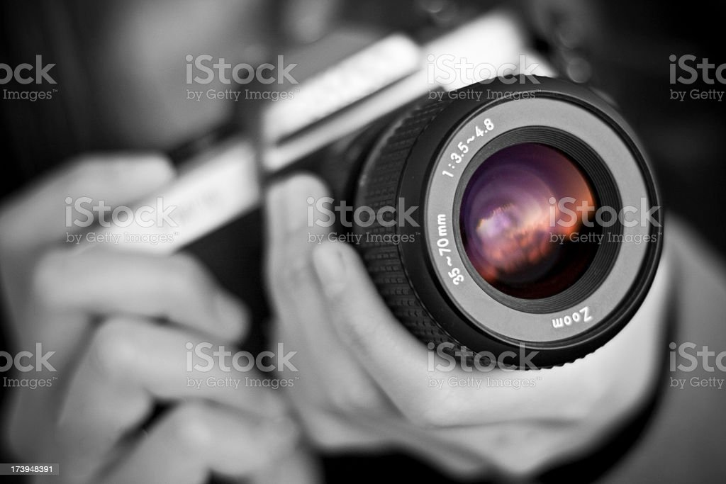 Person holds camera stock photo