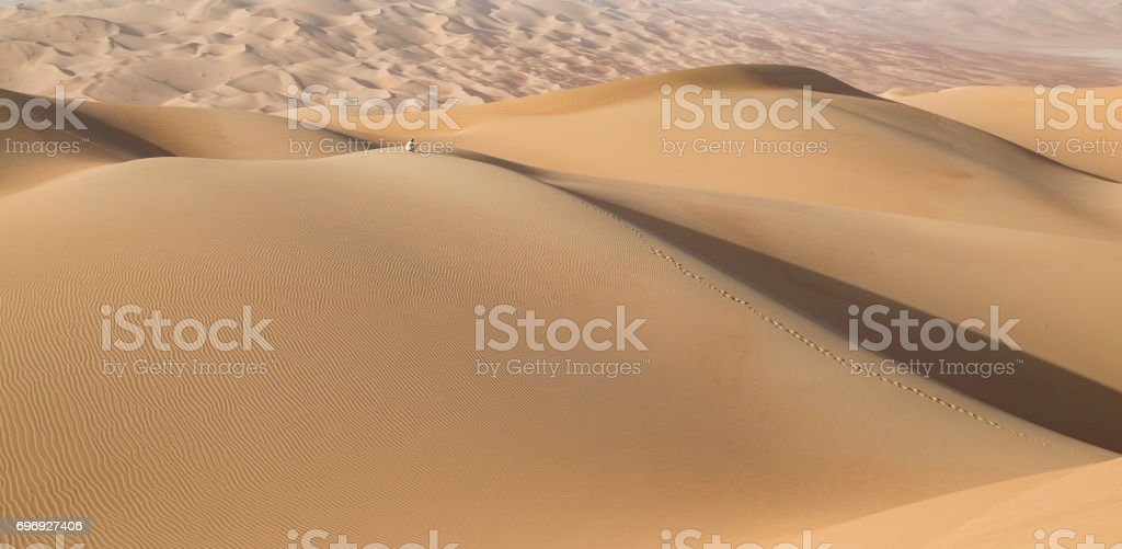 Person in a desert at sunrise stock photo