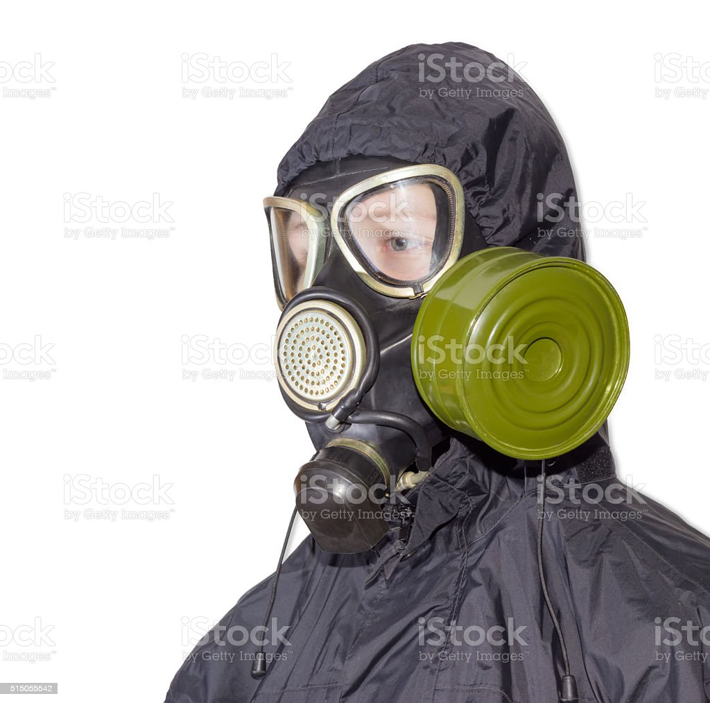 Person in a gas mask on a light background stock photo