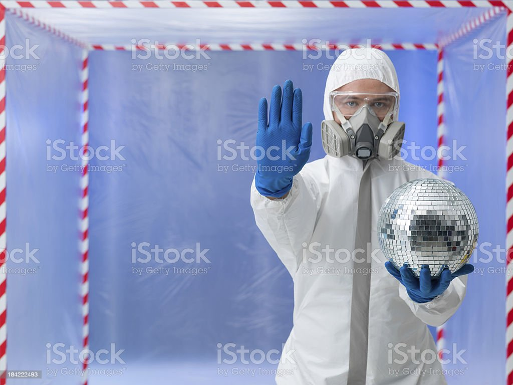 person in biohazard suit warns against contaminantion stock photo