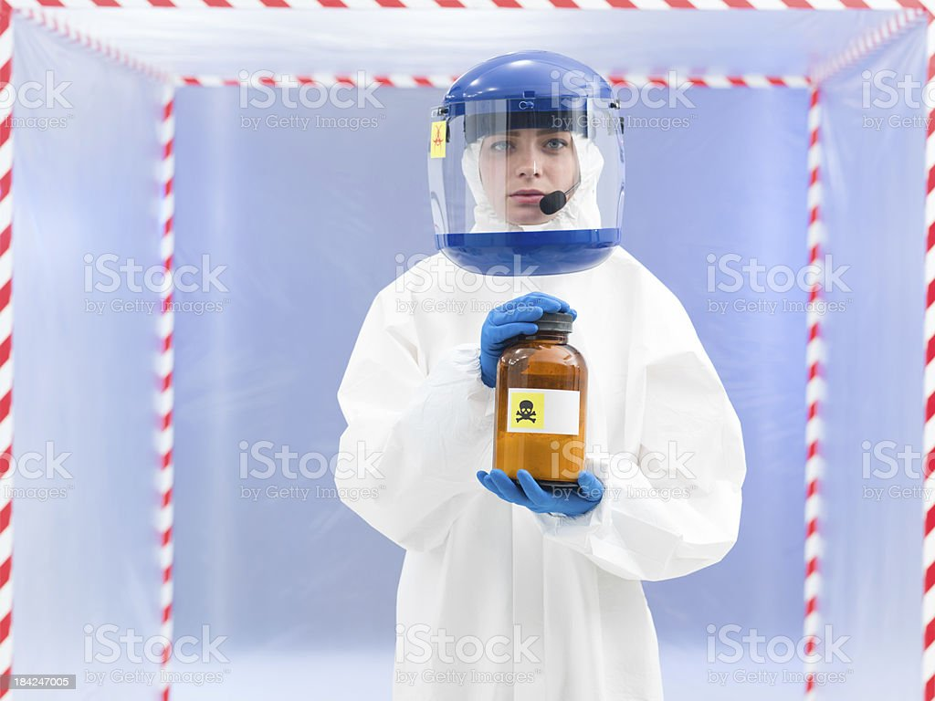 Person in biohazard suit with a toxic substance royalty-free stock photo