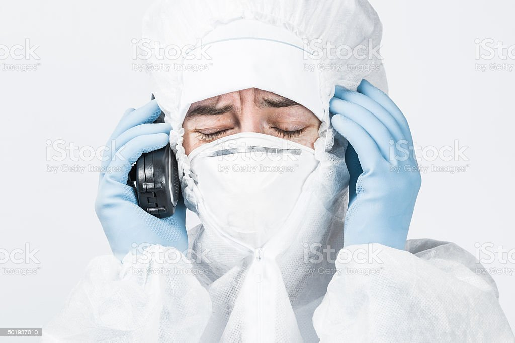 Person in biohazard suit working at laboratory stock photo