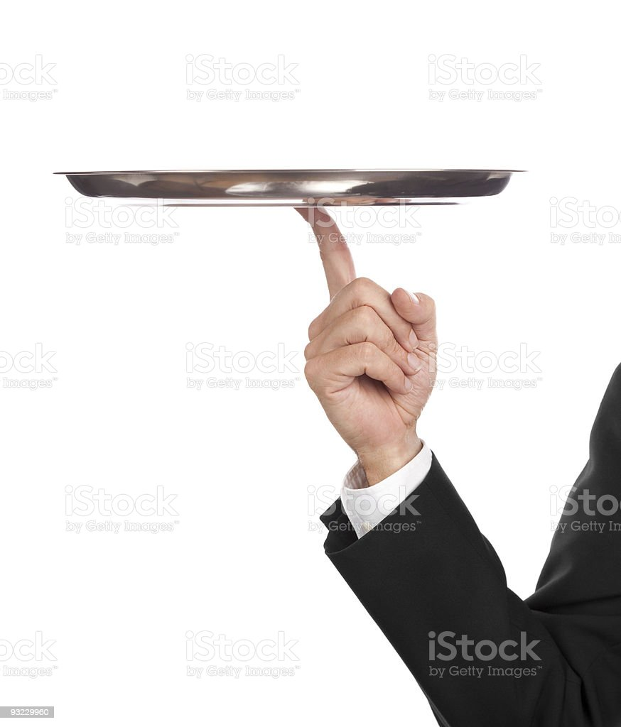 Person in business attire balancing electronics royalty-free stock photo