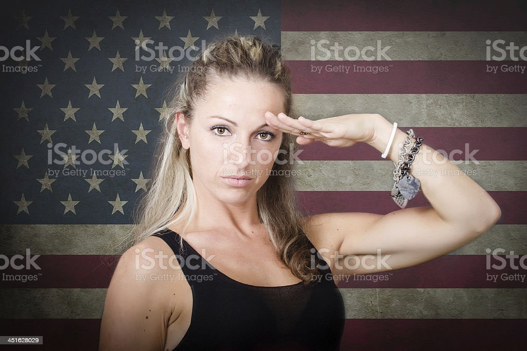person in civil clothes military saluting stock photo