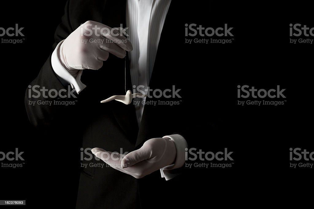 Person in white gloves holding a white dove ornament  stock photo
