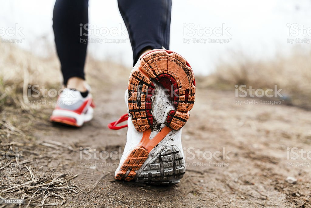 Person in workout pants and sports shoes walking or running stock photo