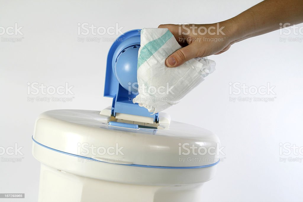 Person inserting used diaper into diaper genie royalty-free stock photo