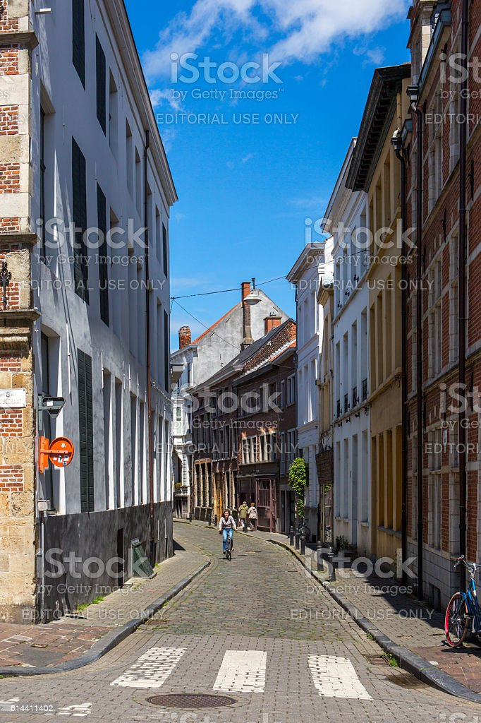 person is riding bcycle at street of ghent belgium stock photo