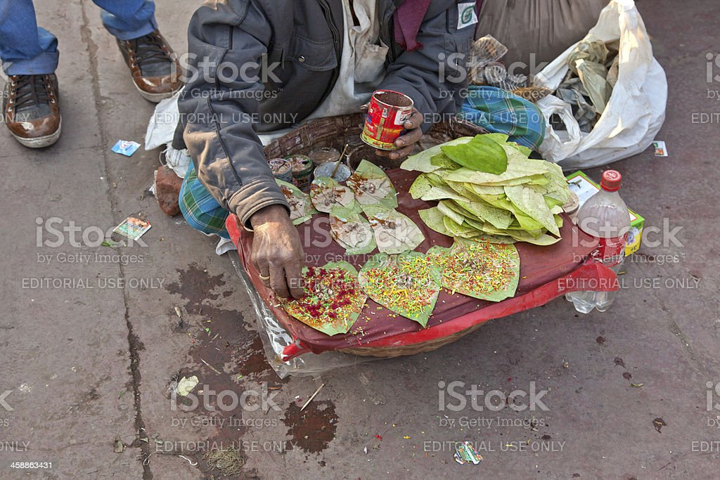 person is selling gutka at marketplace of new delhi india stock photo