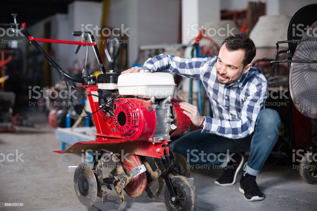 Person is starting to work with plough stock photo