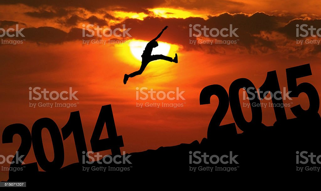 Person jumping over 2015 stock photo