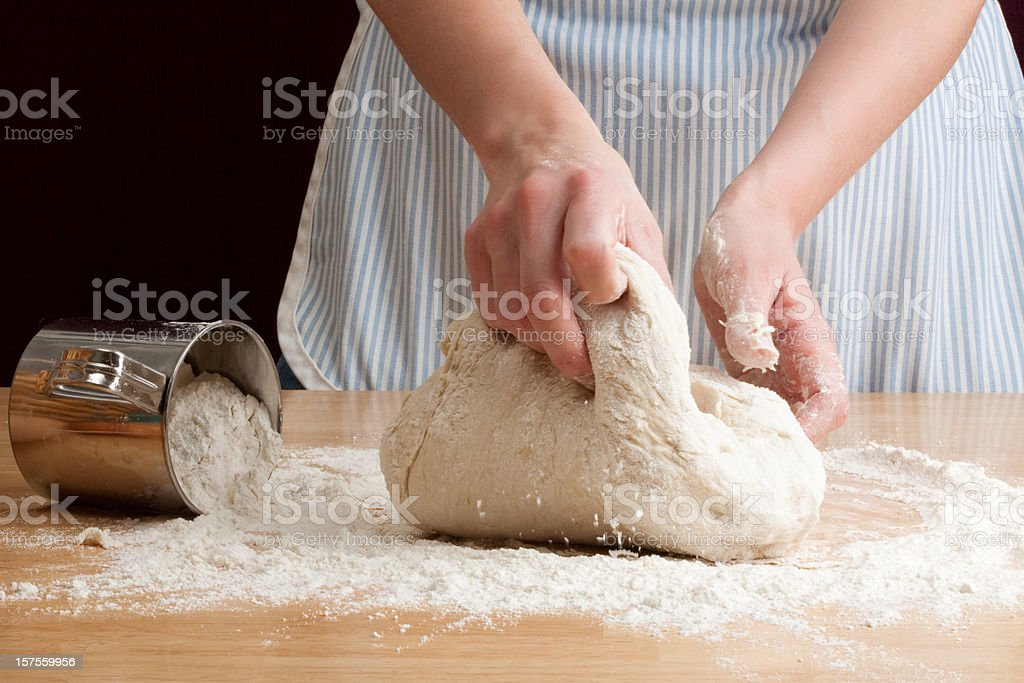 A person kneading dough in the bread making process royalty-free stock photo