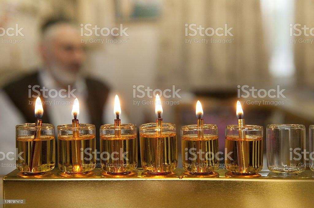 person look at the Hanukkah menorah stock photo