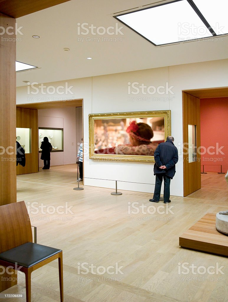 Person looking at art in an art gallery stock photo